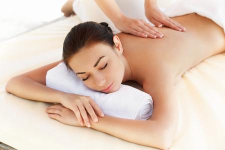 thai spa: Spa Woman. Close-up of a Beautiful Woman Getting Spa Treatment. Massage Stock Photo