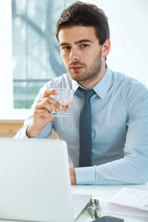 businessman with laptop working in office photo