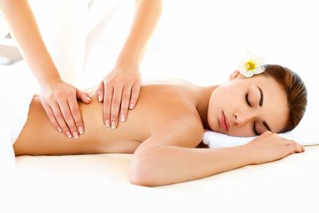 Spa Woman. Close-up of a Beautiful Woman Getting Spa Treatment. Massage Stock Photo
