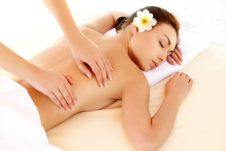 Spa Woman. Close-up of a Beautiful Woman Getting Spa Treatment. Massage Stock Photo
