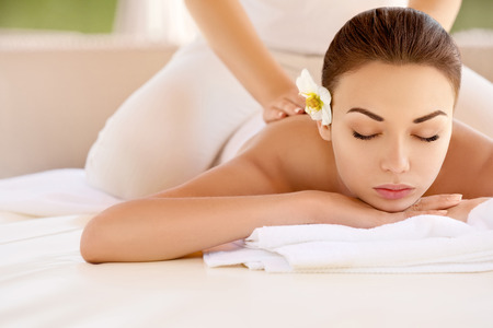 spa treatments: Spa Woman. Close-up of a Beautiful Woman Getting Spa Treatment. Massage Stock Photo