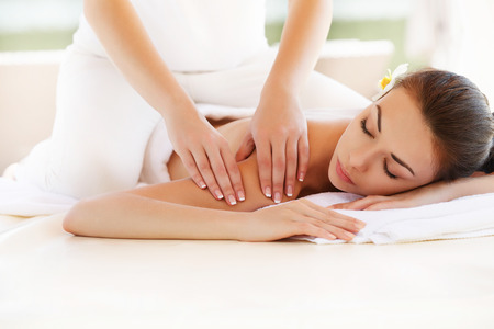 Spa Woman. Close-up of a Beautiful Woman Getting Spa Treatment. Massage photo