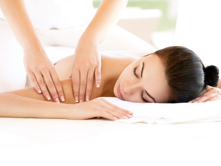 therapist: Spa Woman. Close-up of a Beautiful Woman Getting Spa Treatment. Massage Stock Photo