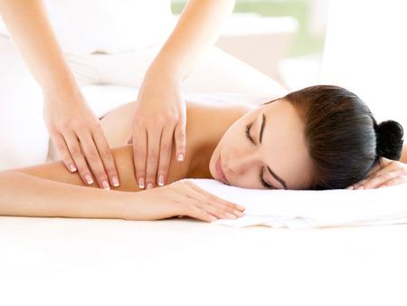 massage: Spa Woman. Close-up of a Beautiful Woman Getting Spa Treatment. Massage Stock Photo