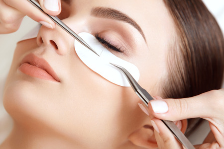 foreigner: Woman Eye with Long Eyelashes. Eyelash Extension