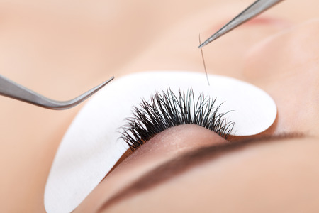 extensions: Woman Eye with Long Eyelashes. Eyelash Extension