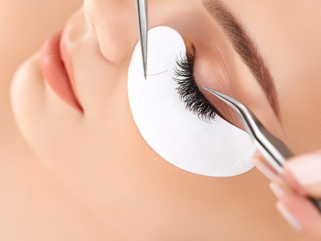 extension: Woman Eye with Long Eyelashes. Eyelash Extension