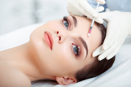 gets: Beautiful Woman gets Injection In Her Face. Cosmetic Surgery Stock Photo