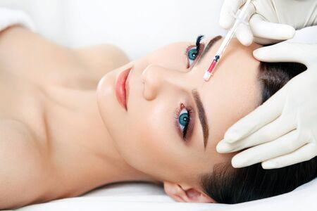beauty skin: Beautiful woman gets injections. Cosmetology. Beauty Face