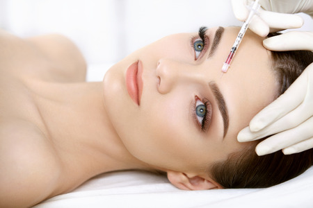 aesthetic: Beautiful Woman gets Injection In Her Face. Cosmetic Surgery Stock Photo