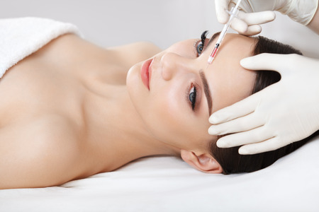 aging skin: Beautiful woman gets injections. Cosmetology. Beauty Face