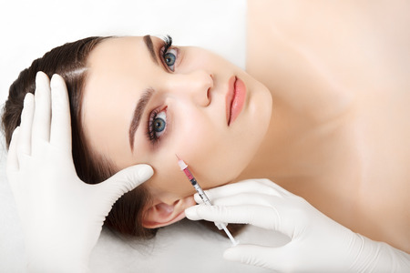surgery: Beautiful woman gets injections. Cosmetology. Beauty Face