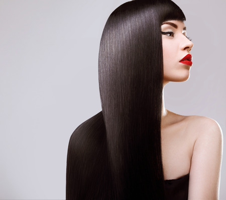 extension: Hair. Beautiful Woman with Healthy Long Hair. Red Lips and nice Makeup. Black Hair