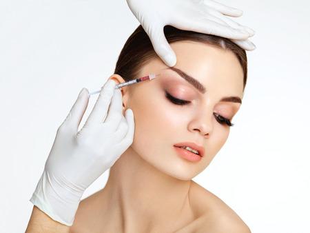 kunststoff: Schöne Frau erhält Injektionen. Kosmetologie. Schönheits-Gesicht