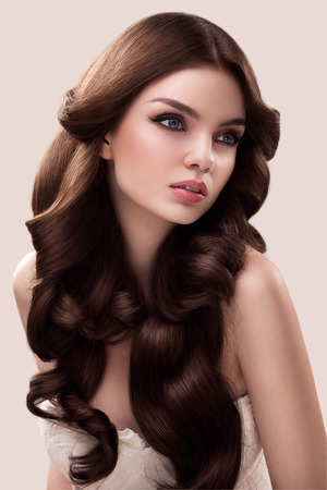 hair studio: Hair. Portrait of Beautiful Woman with Long Wavy Hair. High quality image.