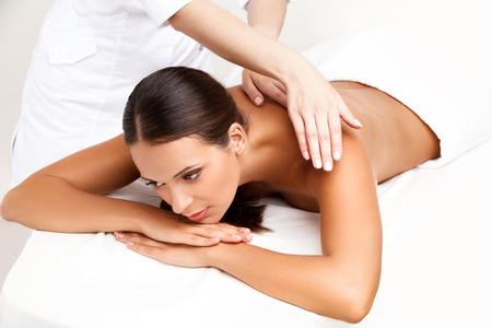 dayspa: Massage. Close-up of a Beautiful Woman Getting Spa Treatment