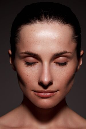 one eye closed: Close-up portrait of beautiful young woman with eyes closed Stock Photo