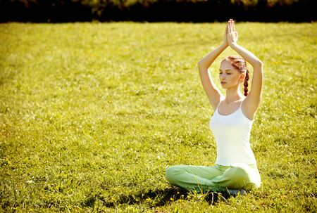 a serene life: Young and beautiful woman doing yoga exercises .Yoga background