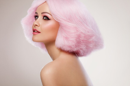 Beauty Fashion Model Girl with Pink Hair. Colourful Hair. Colouring hair