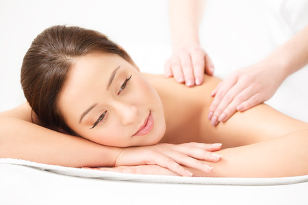 hands on face: Massage. Close-up of a Beautiful Woman Getting Spa Treatment in Spa Salon