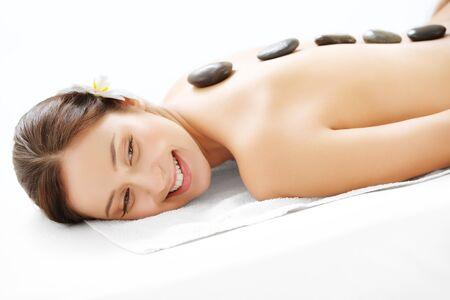 hot stones: Spa Treatment. Stone Massage. Beautiful Woman Getting Spa Hot Stones Massage in Spa Salon. Stock Photo
