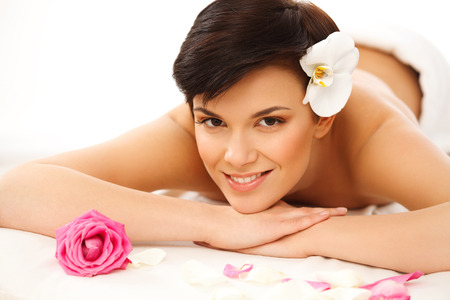 Spa Woman. Close-up of a Beautiful Woman Getting Spa Treatment Spa Salon. photo