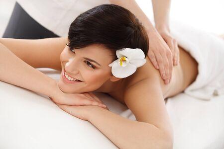 dayspa: Spa Woman. Close-up of a Beautiful Woman Getting Spa Treatment. Massage Stock Photo