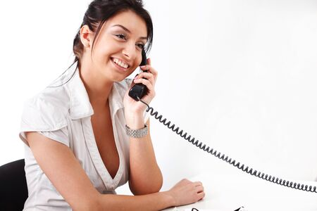 Portrait of beautiful business woman on phone call over white background photo