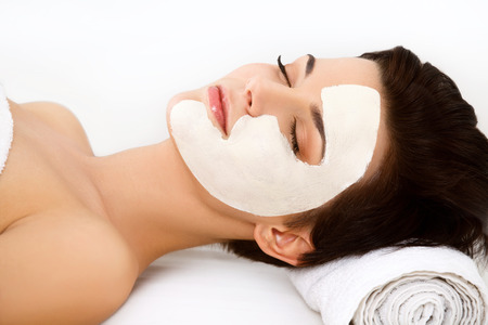 facial cleansing: Spa Mask. Woman in Spa Salon. Face Mask. Facial Clay Mask. Treatment Stock Photo