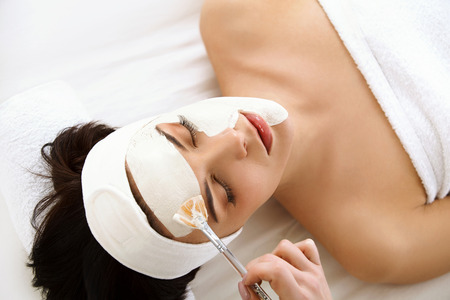 treatments: Spa Mask. Woman in Spa Salon. Face Mask. Facial Clay Mask. Treatment Stock Photo