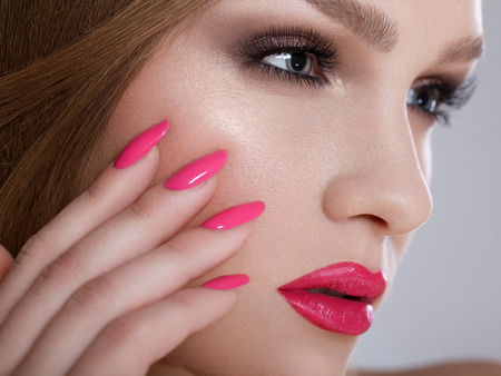 Manicure and Makeup. Beautiful Woman With Pink Nails and Luxury Makeup. Red Sexy Lips and Long Eyelashes