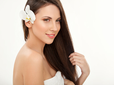 Brown Hair. Beautiful Brunette with Long Hair. Haircare. Spa Beauty Model