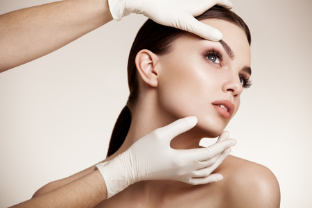 lift hands: Beautiful Woman before Plastic Surgery Operation Cosmetology. Beauty Face Stock Photo