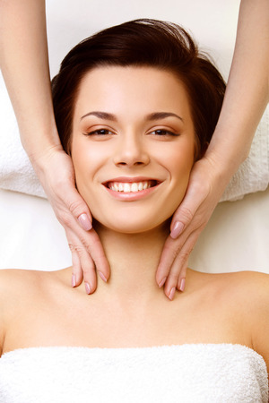 dayspa: Spa Woman. Close-up of a Young Woman Getting Spa Treatment. Face Massage Stock Photo