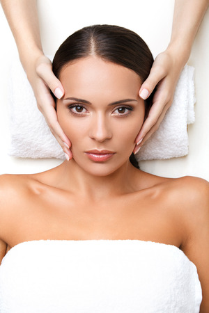 dayspa: Face Massage. Close-up of a Young Woman Getting Treatment in Spa Salon Stock Photo