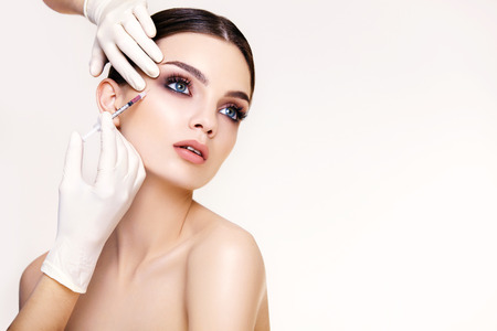 beauty treatment clinic: Beautiful woman gets injections. Cosmetology. Beauty Face