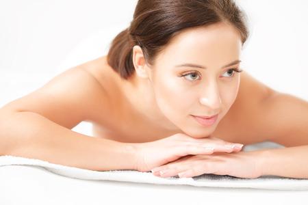 Spa Woman. Close-up of a Beautiful Woman Getting Spa Treatment. Spa Salon photo