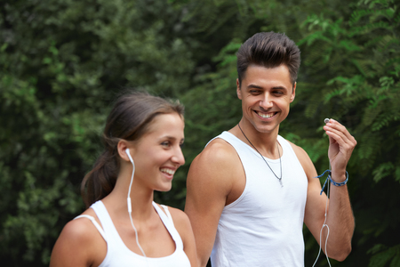 summer sport: Sport couple walking in the summer park