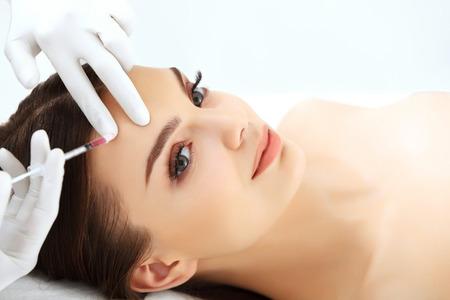 Beautiful woman gets botox injections. Cosmetology. Beauty Face