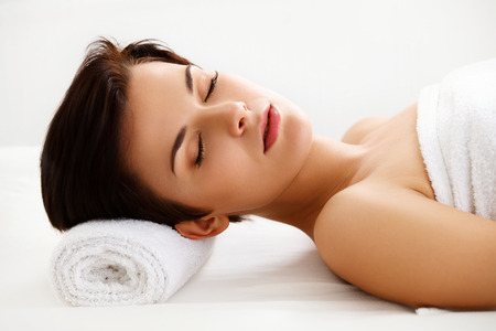 dayspa: Spa Woman. Beautiful Woman Relaxing in Spa Salon. High quality image