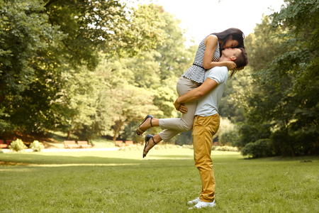 kiss love: Couple in Love. Happy couple kissing in the park. Stock Photo