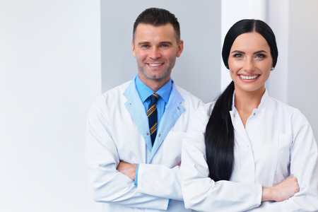 doctors smiling: Dentist Team at Dental Clinic. Two Smiling Doctors at their Workplace