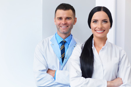 medical career: Dentist Team at Dental Clinic. Two Smiling Doctors at their Workplace