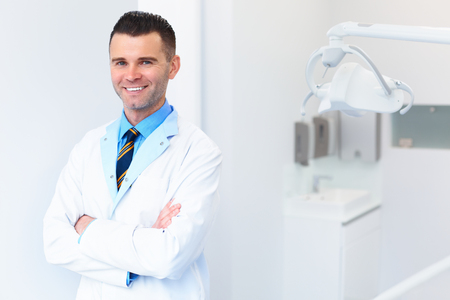 dentist: Dentist Doctor Portrait. Young Man at His Workplace. Dental Clinic Stock Photo