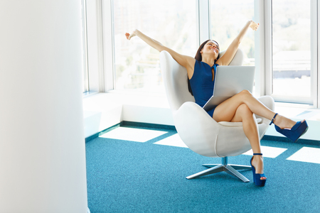 Business Woman Celebrates Successful Deal at office. Bussiness People Foto de archivo