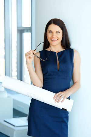 female architect: Young Female Architect Standing in an Office. Business People