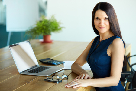 woman in office: Business Woman using her Laptop Computer at office. Business People Stock Photo