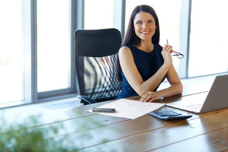 happy businesswoman: Business Woman using her Laptop Computer at office. Business People Stock Photo