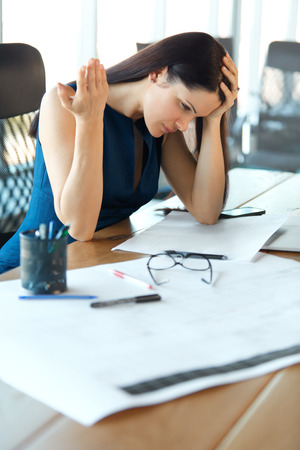 stressed business woman: Stressed business woman at her working place. Business People