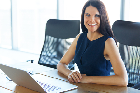 young female: Business Woman using her Laptop Computer at office. Business People Stock Photo